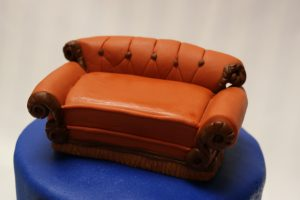 The famous couch from the tv show Friends , sculpted in marshmallow fondant