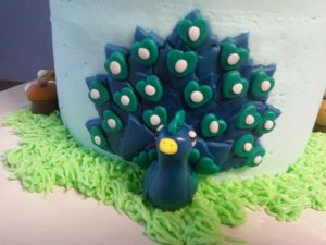 miniature peacock sculpted in marshmallow fondant