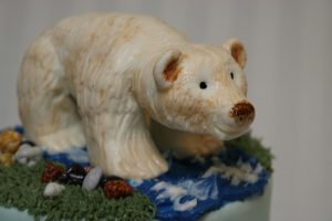 spirit bear sculpted out of marshmallow fondant